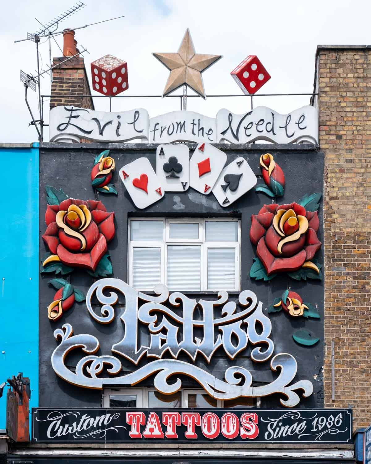 Vibrant painted exterior of a tattoo parlour on Camden high Street