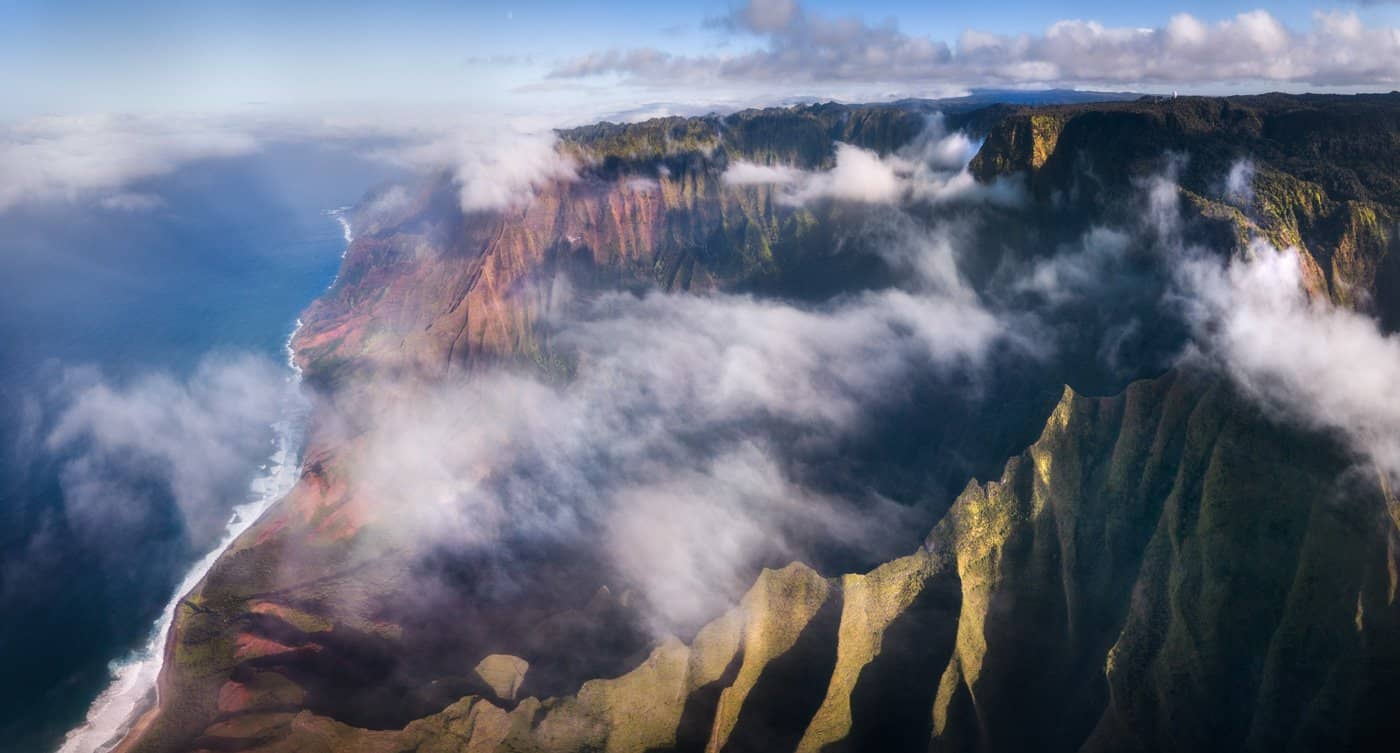 Late light and fast-moving clouds make Kalepa Ridge a favorite location for sunset in Kauai.