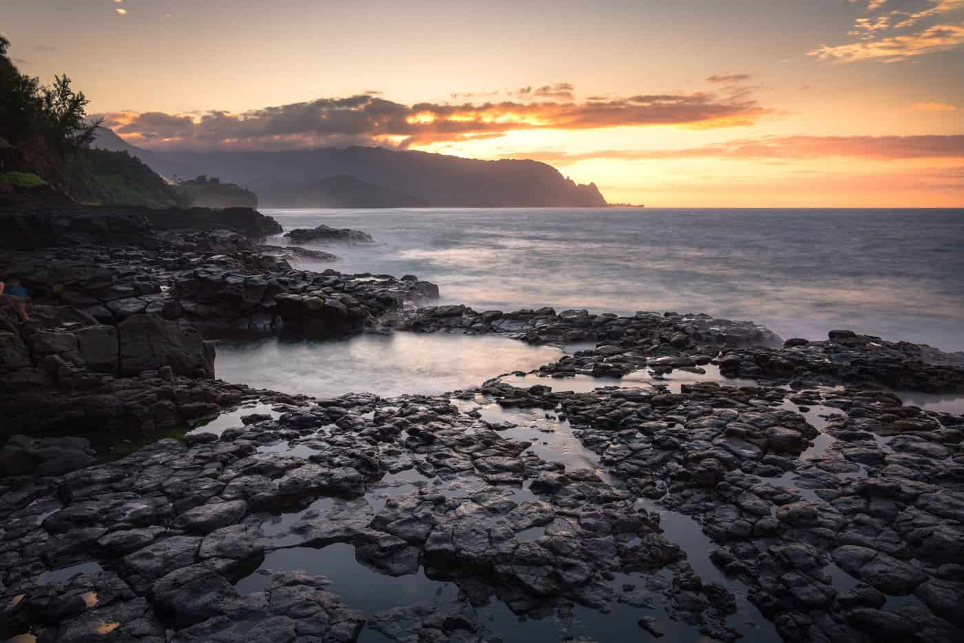 The lava-forged Queen's Bath is arguably the best place for photographing Kauai sunsets.