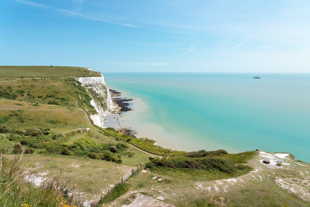 Scenic view of the White Cliffs of Dover and a ship in the distance