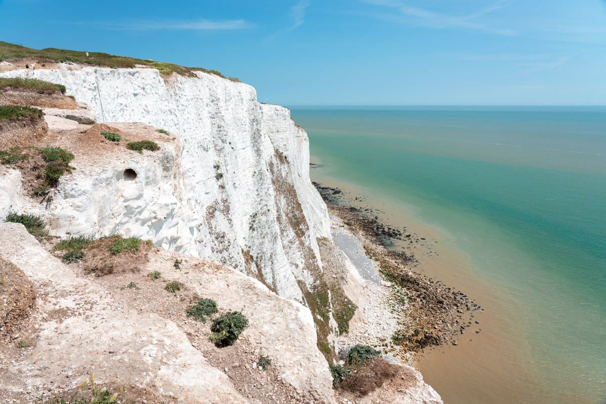 Exposed white chalk faces of the cliffs of Dover