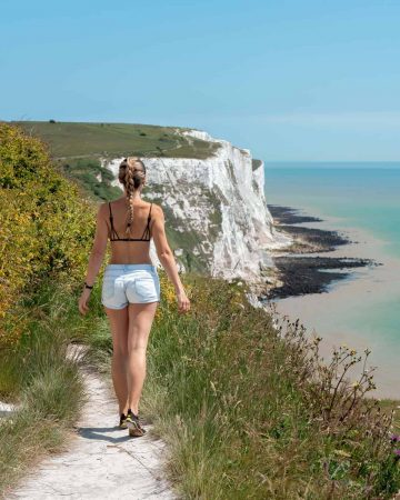 A girl walking along the edge of the White Cliffs of Dover