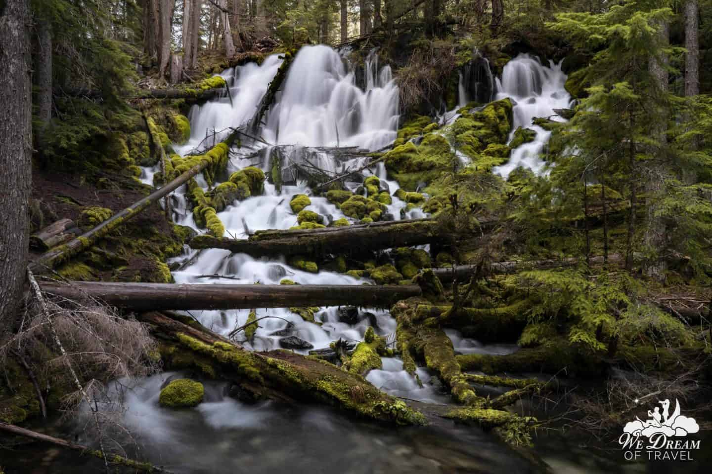 Crystal-clear water tumbles its way over moss covered rock at Clearwater Falls.