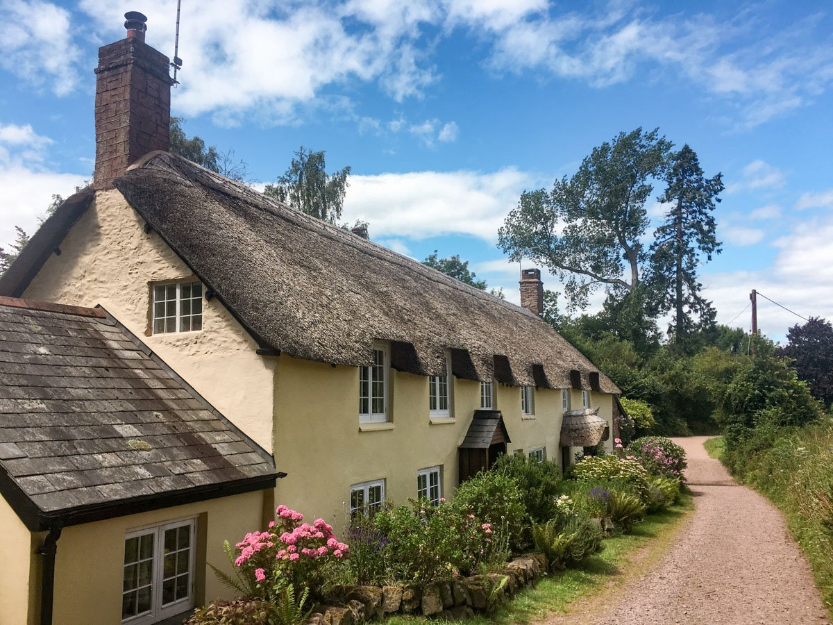 Thatched cottages in the medieval English village of Dunster, Somerset.