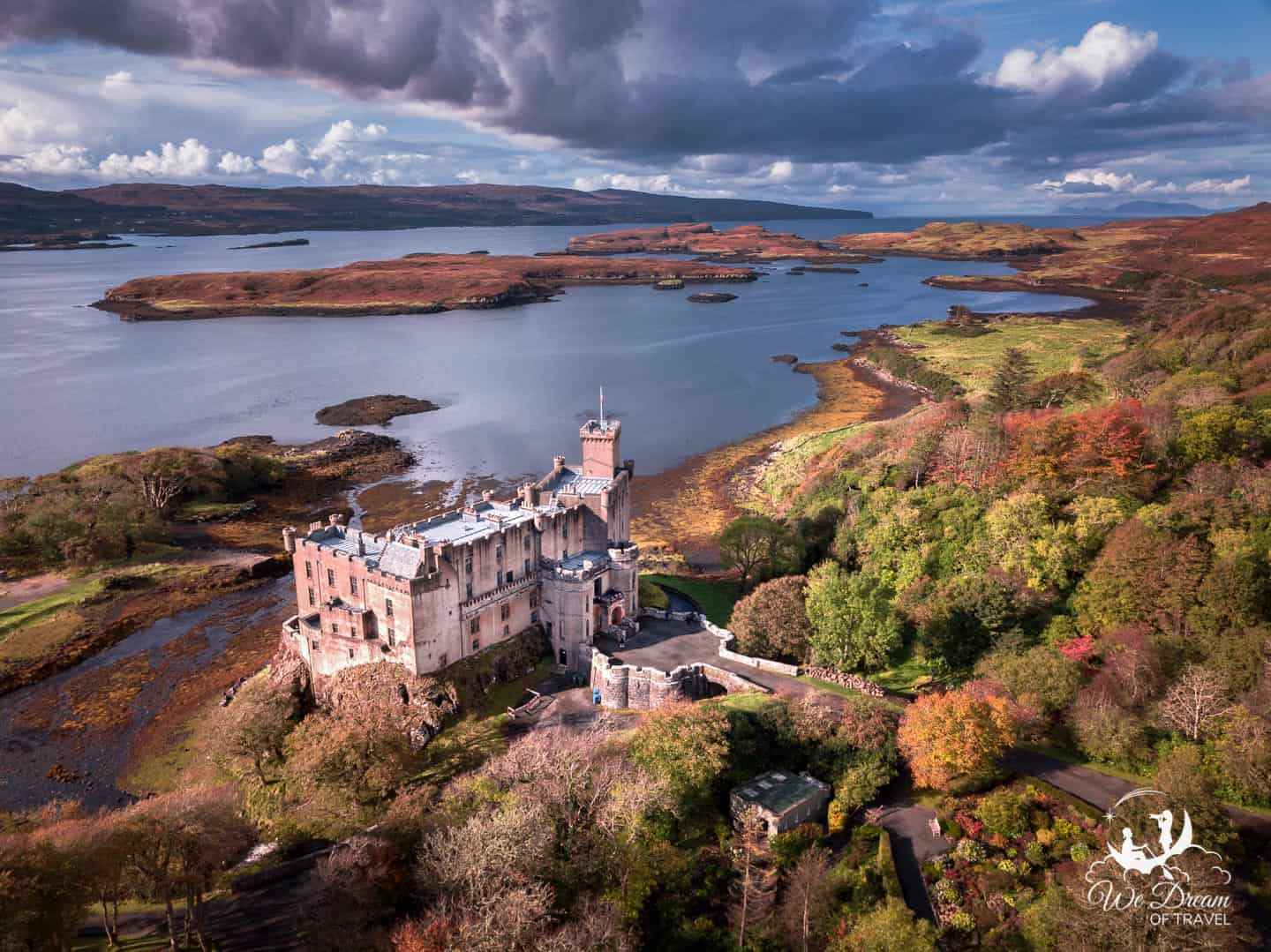 Aerial photography showing Dunvegan Castle set against the gorgeous Isle of Skye scenery.