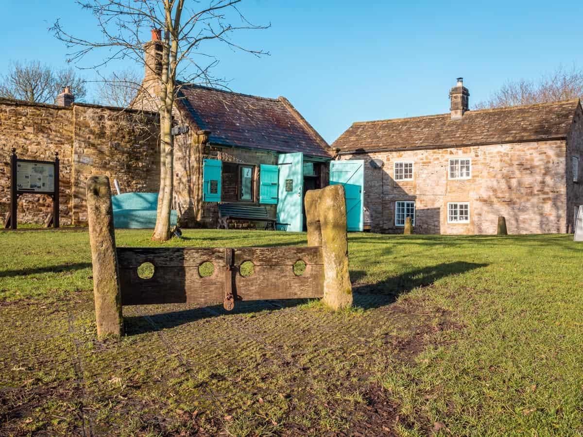 Stocks and market hall on Eyam village green, Derbyshire, England.