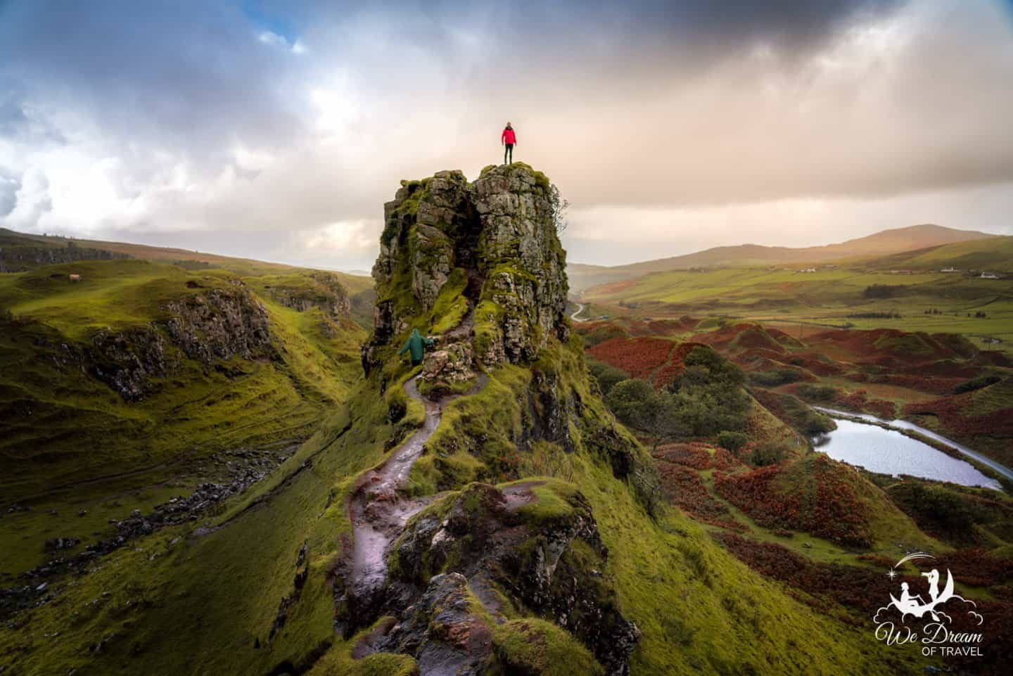 Adam poses for scale on the summit of Castle Ewan in Fairy Glen.