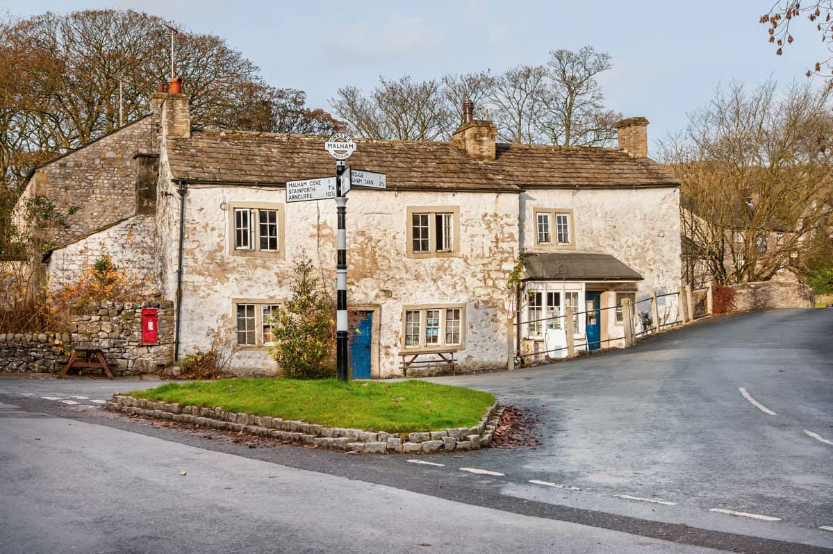 Road junction within the picturesque English village of Malham, Yorkshire.