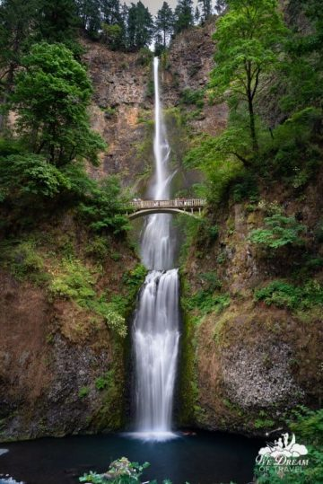 Long exposure image of Multnomah Falls in Oregon, demonstrating that tall waterfalls are best photographed in vertical mode.