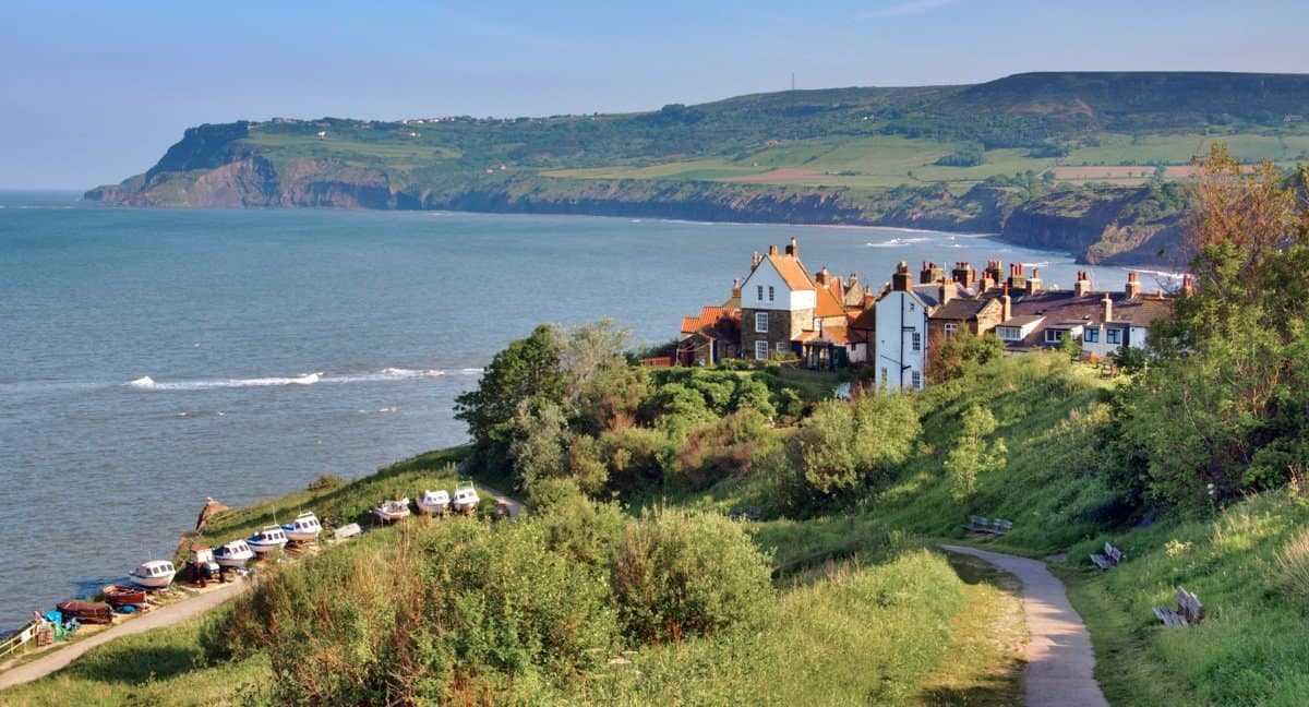 The beautiful village of Robin Hood's Bay as seen from the coastal path looking back over the English village and coast.