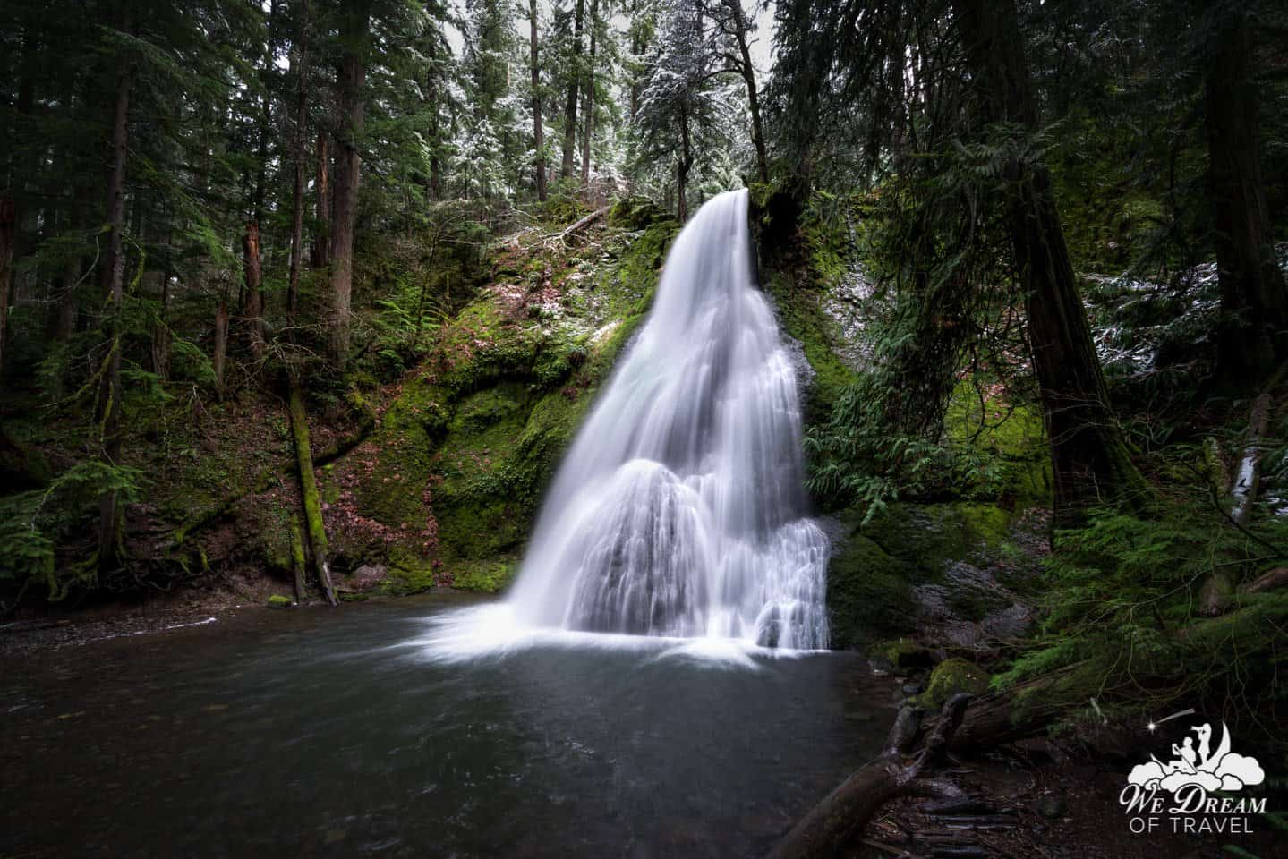 "We have taken to calling this Oregon waterfall ""Pregnant Falls"" due to the large protruding boulder at its base."