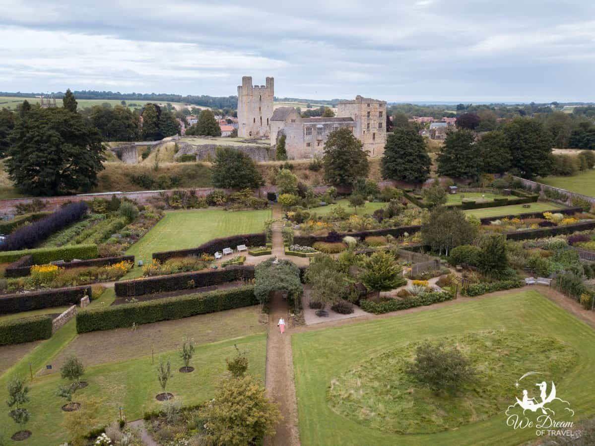 A drone aerial image of Helmsley Walled Gardens and Helmsley Castle.