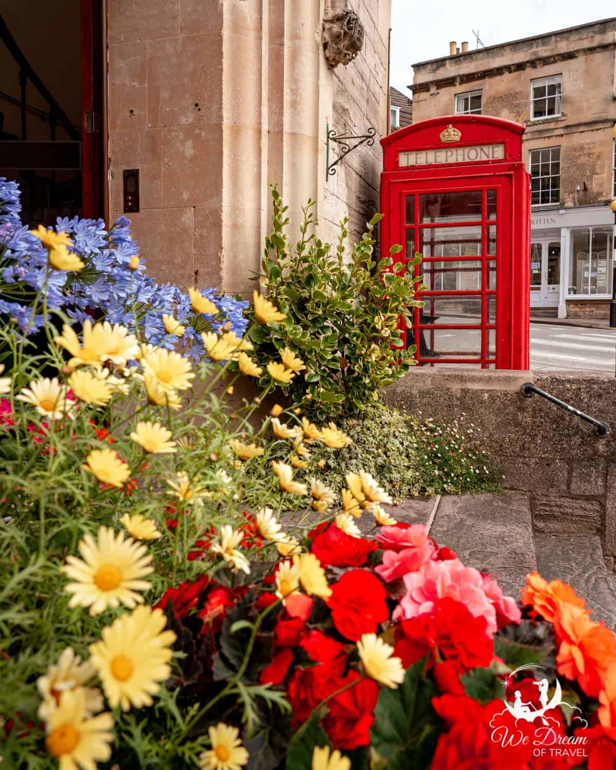 Flowers and a red phone box in Bradford on Avon