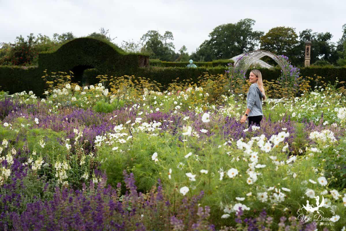 A girl amongst flowers in the Walled Gardens of Castle Howard.