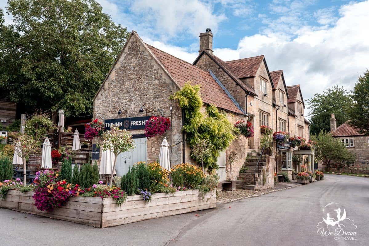 The Inn Freshford Village descorated with colourful flowers.