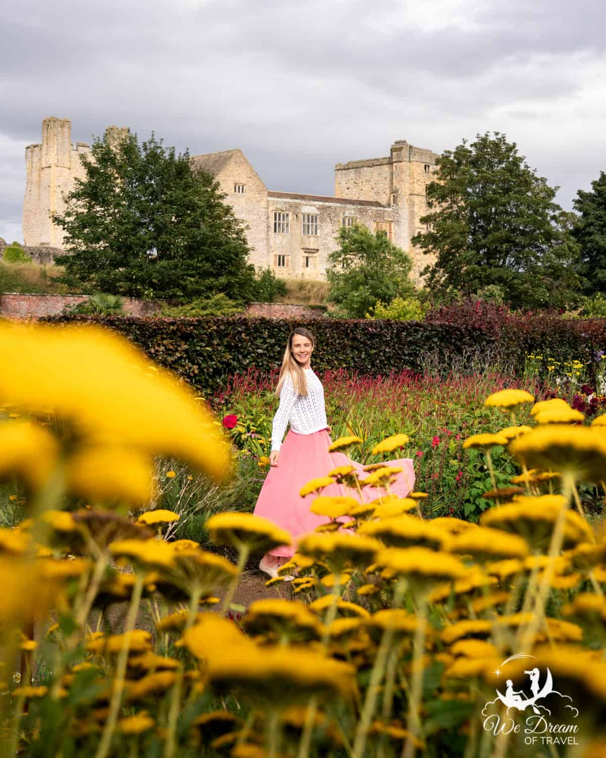 Girl dancing amidst the flowers of Helmsley Walled Gardens