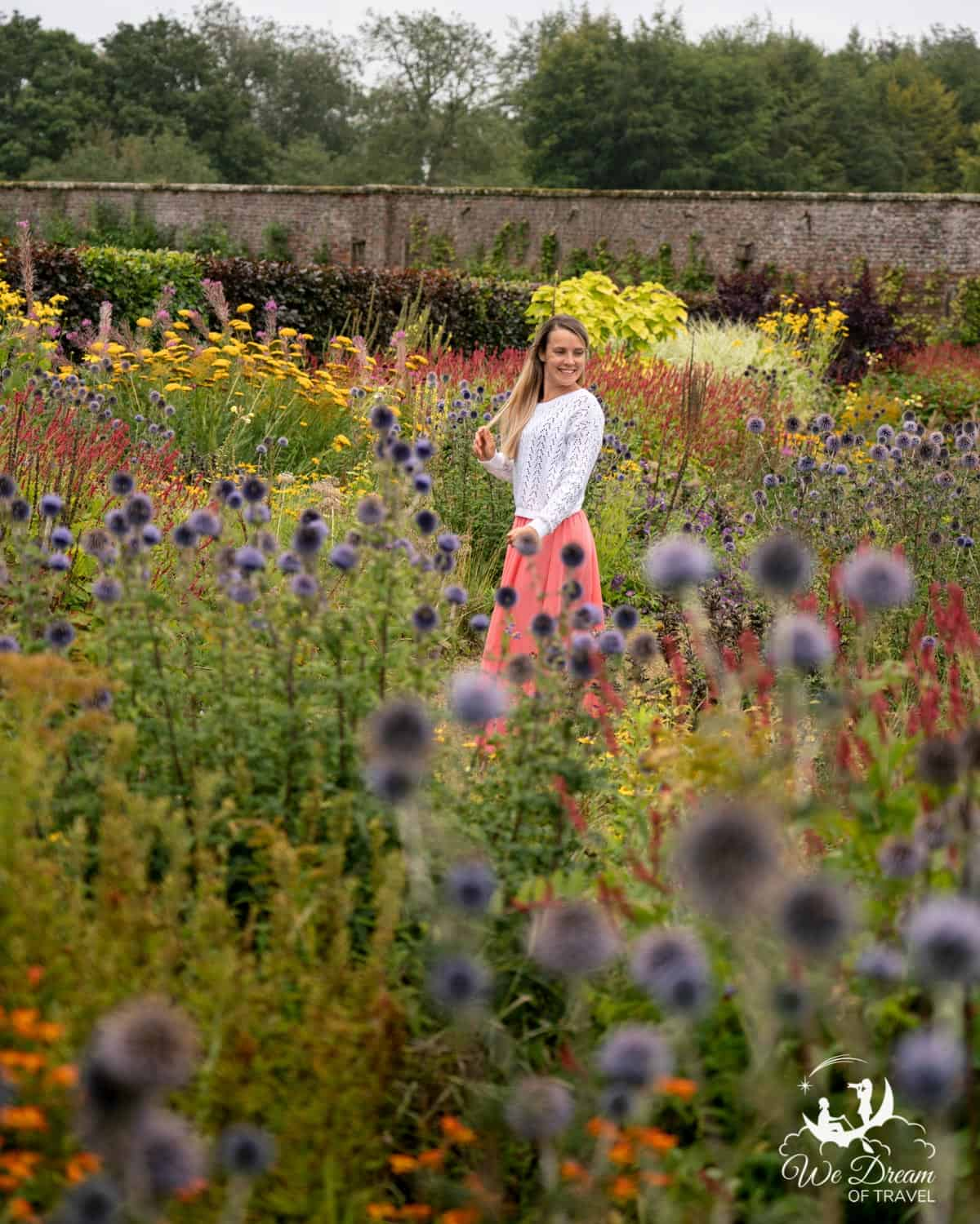 A girl amongst a sea of flowers at Helmsley Walled Gardens - one of the best day trips from York