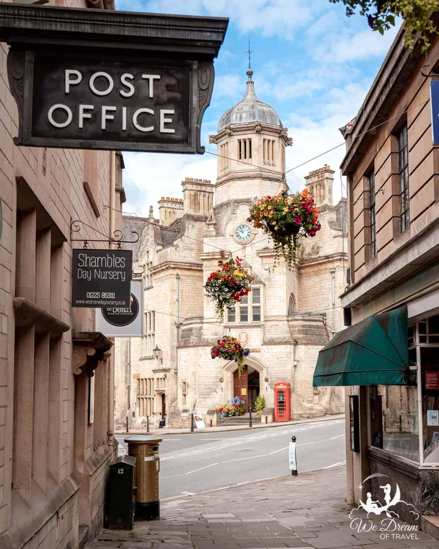 Beautiful narrow street with hanging baskets in Bradford on Avon England