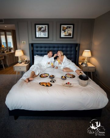 Adam and Sophie from We Dream of Travel enjoying breakfast in bed at The Grand Hotel York.