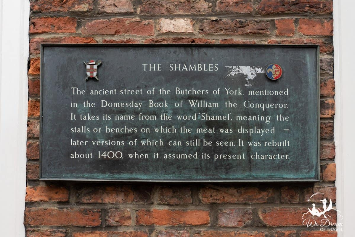 A sign about The Shambles seen on a brick wall in York