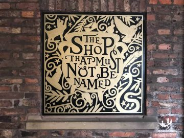 """A sign for the Harry Potter shop """"The shop that must not be named""""."""
