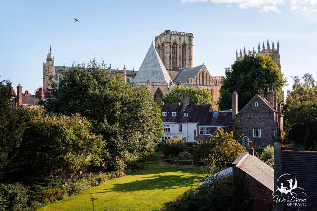 View of a garden and the York Minster from York city walls.