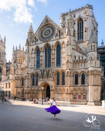 A girl twirling in a skirt in front of York Minster - one of the best places to visit in York England.