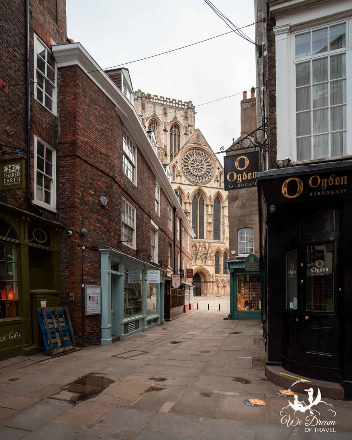 York Minster visible at the end of Minster Street, a narrow street