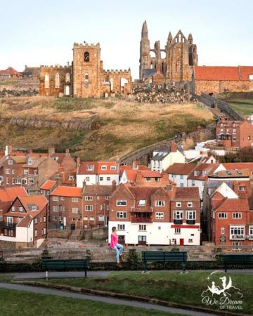 View of Whitby Abbey from East Terraces during golden hour before sunset