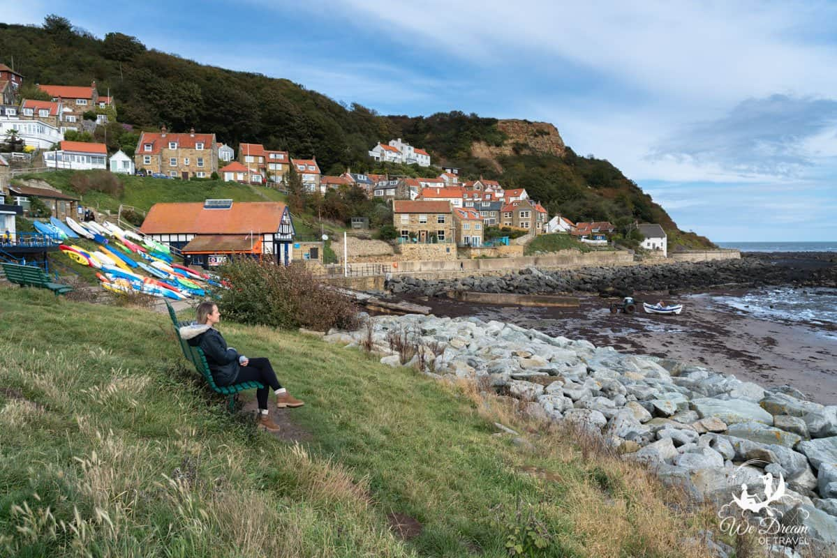 Enjoying the ocean view from Runswick Bay, surrounded by red roofed houses and colourful boats.