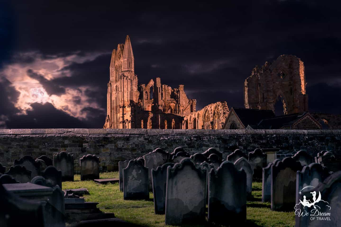 Whitby Abbey and St Mary's Church graveyard at night - inspiration for Dracula and a top thing to see in Whitby