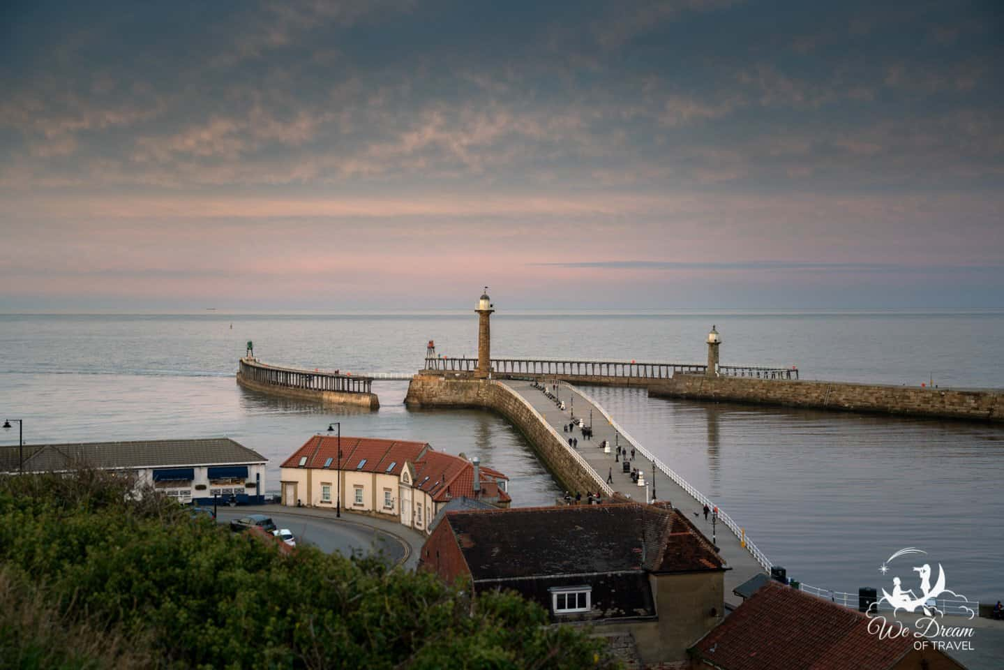 Whitby Piers (east and west pier) and lighthouses as sunset colours fade.