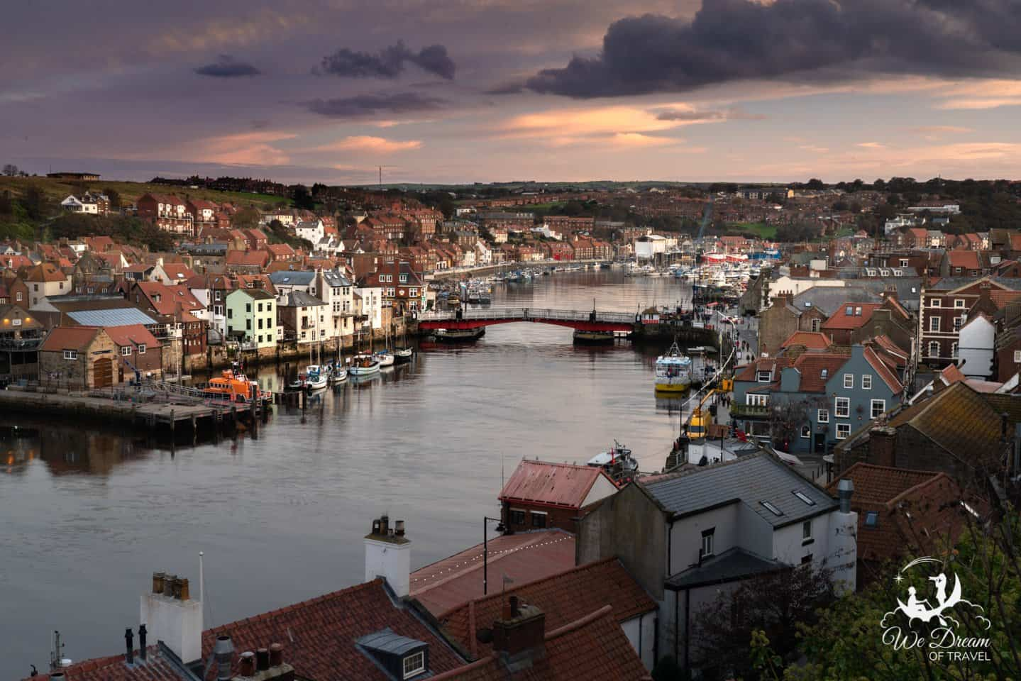 Sunset over Whitby town and harbour from East Terrace.
