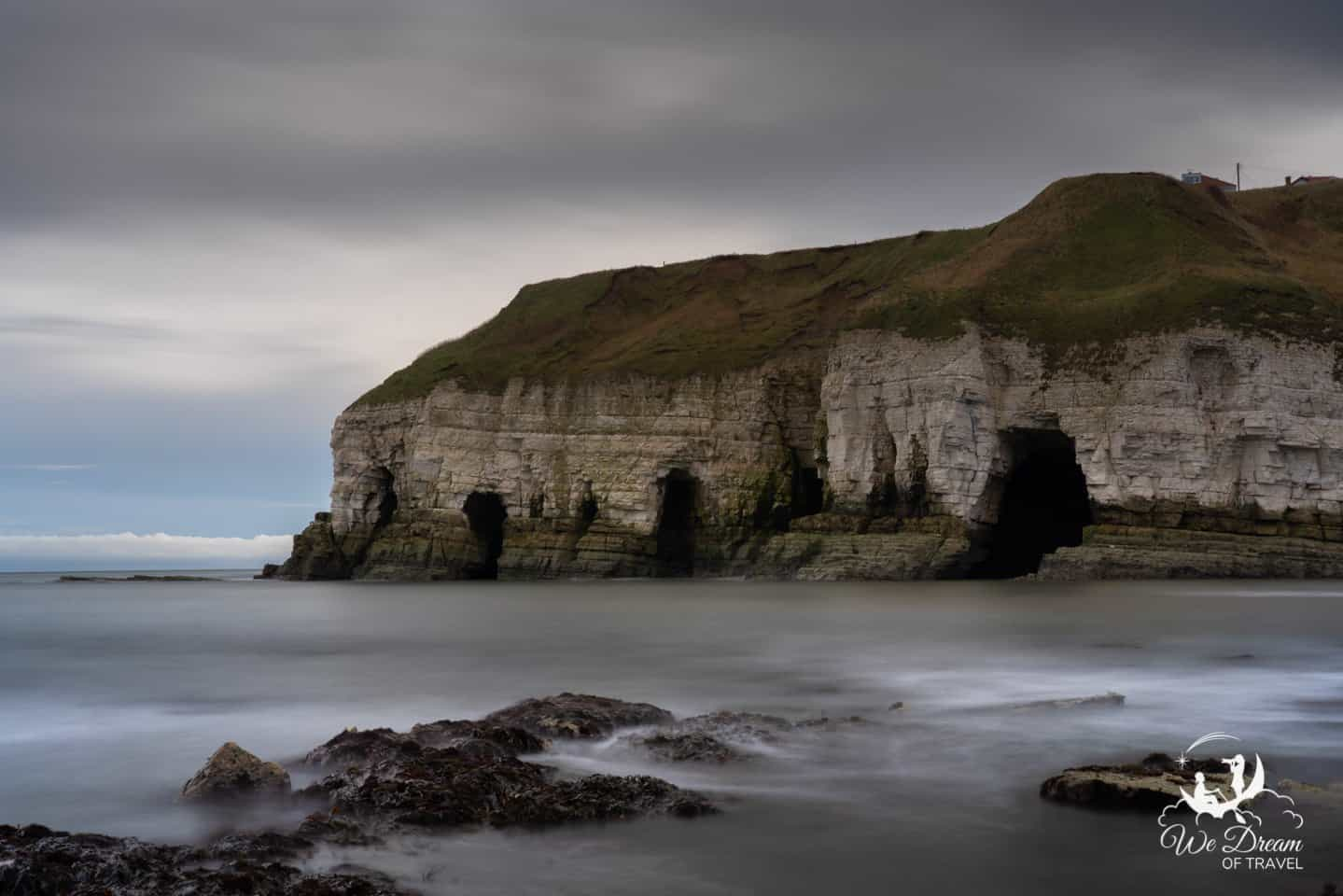 A long exposure photo of the emerging sea caves at Thornwick Bay.