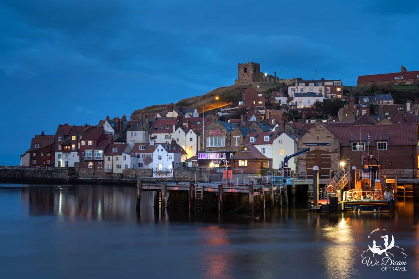 Long exposure photography of Whitby Harbour during the blue hour.