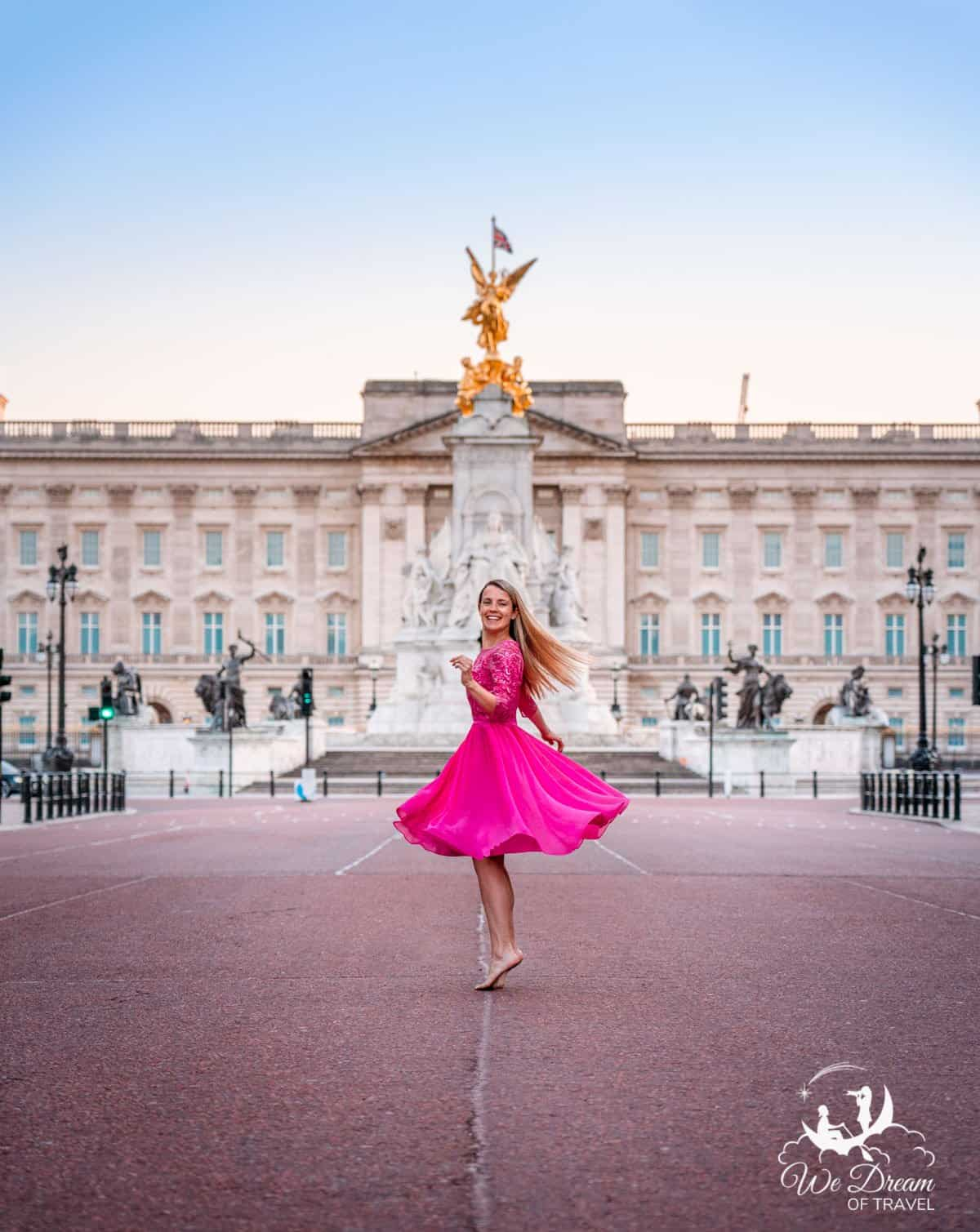 Twirling in a pink dress on The Mall in front of Buckingham Palace and Victoria Memorial at sunset