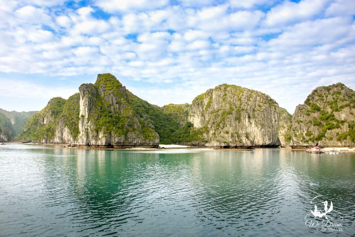 Thousands of limestone islands amongst emerald waters make up Hạ Long Bay, Vietnam.