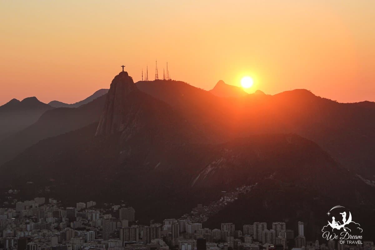 Sunset behind Christ the Redeemer and Rio de Janeiro in Brazil from Sugar Loaf Mountain.