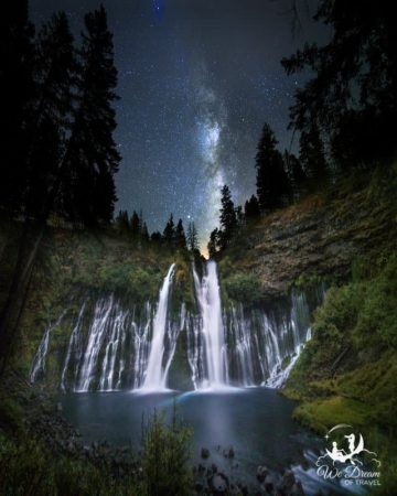 Night photography of Burney Falls with the Milky Way setting into the waterfall.