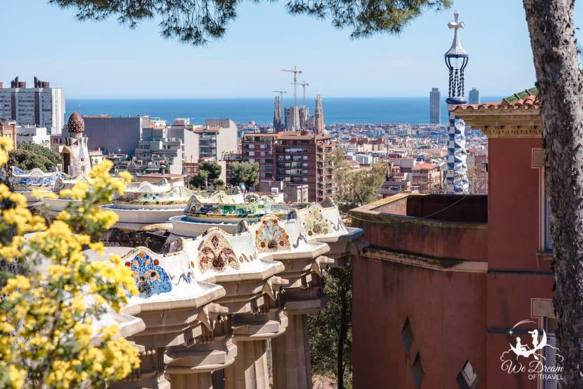 Gaudí's Park Güell in Barcelona offers dreamy views over the city towards the sea.