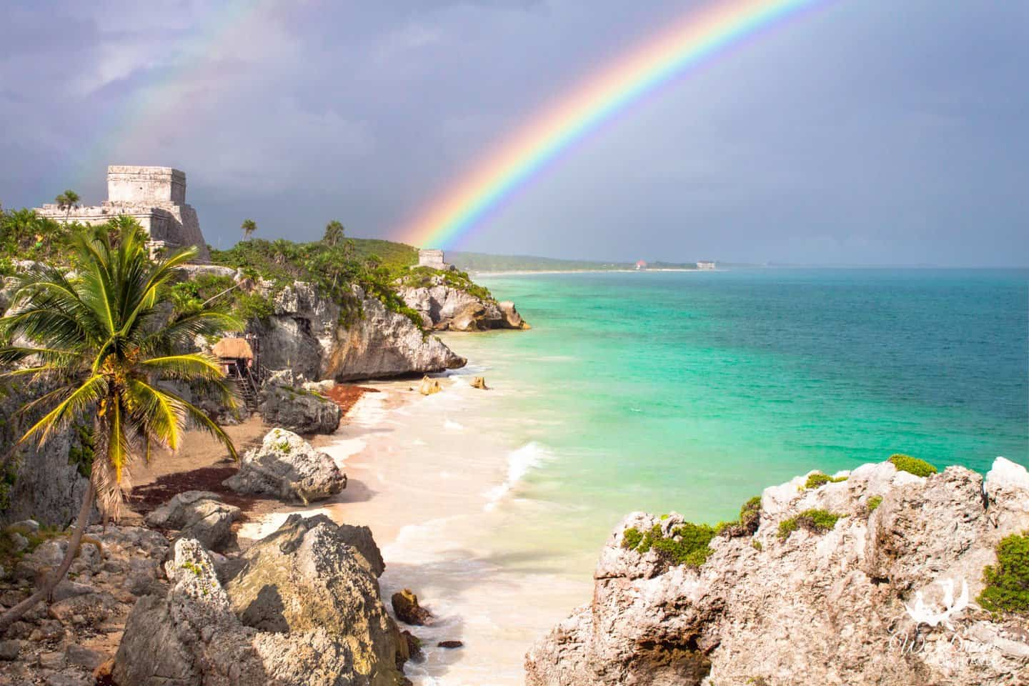 The old Tulum ruins are graced with a vibrant rainbow and nothing but paradise surrounding.