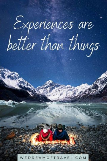 "Traveling Lessons #15 ""Experiences are better than things"" quote overlaying an image of a couple on a blanket at Hooker Lake, Mt Cook, gazing up at the milky way."