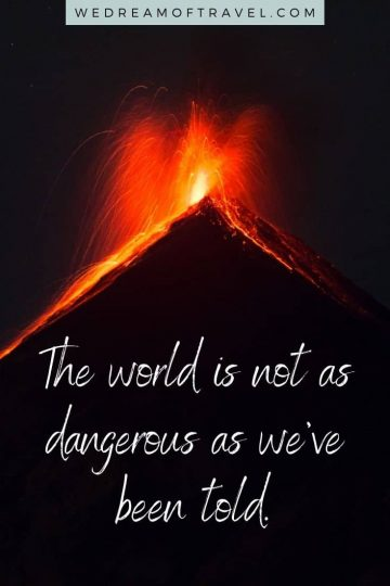 """Traveling lesson #4  """"The world is not as dangerous as we've been told."""" travel quote overlaying image of a volcano erupting"""
