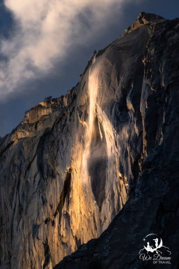 Horsetail Falls blowing in the wind as the golden hour begins.