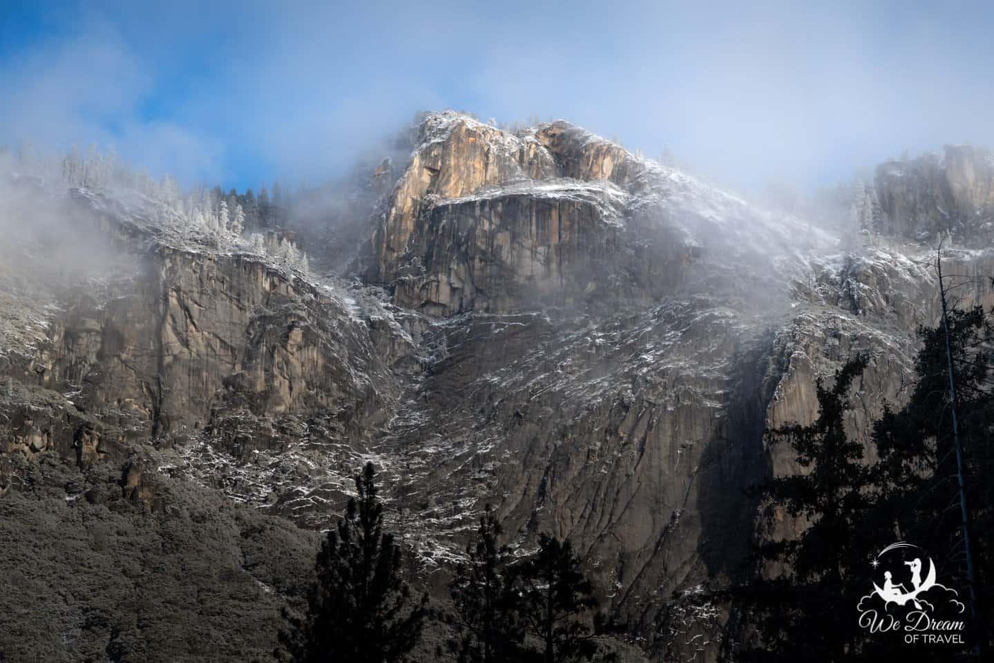 The granite cliffs of Yosemite shine golden in the morning sunlight.