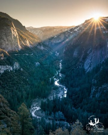 The sun rises over the Merced River on a day trip to Yosemite.