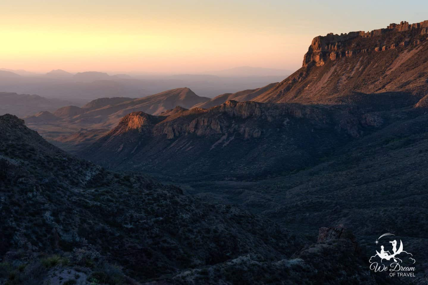 Sunrise photography from Lost Mine Trail shows the Chisos Basin in golden light.