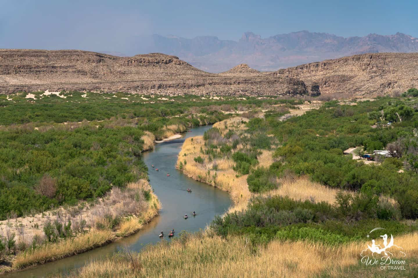 Kayakers navigate the Rio Grande river in this photo from the Rio Grande Nature Trail.