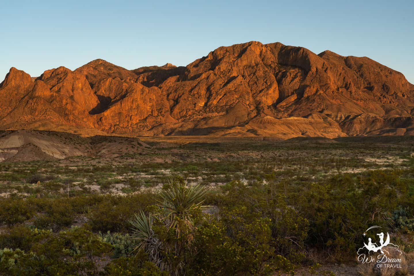 The Chisos Mountains glow with vibrance in the evening golden hour.