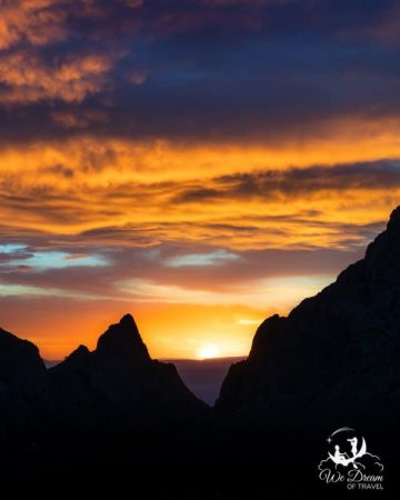 "A skyfire sunset through ""The Window"" in the Chisos Basin of Big Bend National Park."
